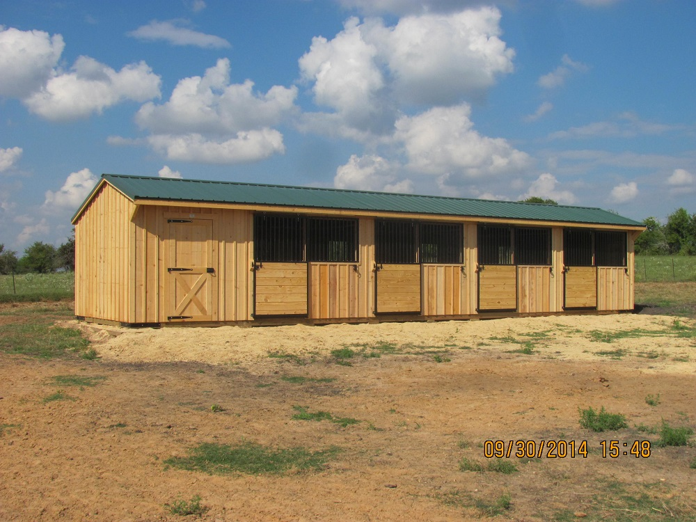 10 39 portable horse barns shedrow barns deer creek for Cost of building a horse barn